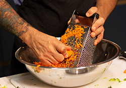 Grating carrots into bowl