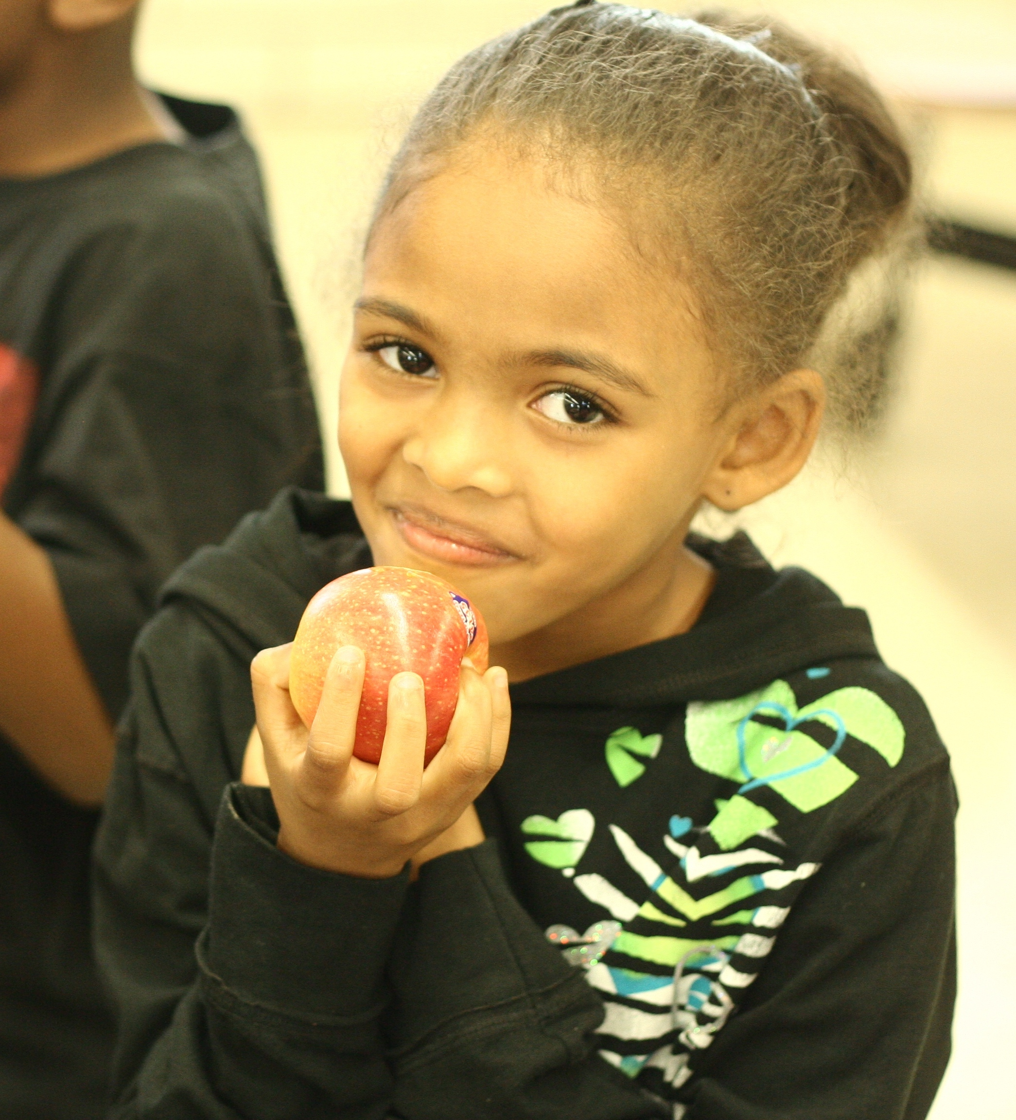 Andrews Elementary Student with Apple